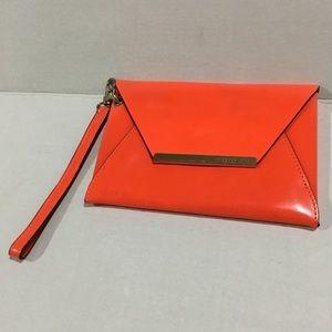 BCBG Orange Mini Harlow Clutch. BNWT.